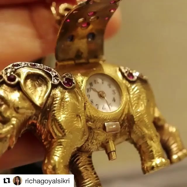 "Thank you Richa for the lovely post! We love our little elephant pocket watch.  #Repost @richagoyalsikri ・・・ A very special antique timepiece from the 1800's Just imagine it hanging from an elegant creature's neck, and very casually, he/she pops open the cover to check the time...""its 0200 am, too early to leave the soirée"". Besides the decadence of the concept, what impressed me most are the contours on the Gold Elephant, the muscles, the wrinkles, the eyes...it's as if he wants to break the chain he is hanging from and roam free... . Video by @richagoyalsikri  Pendant by @revivaljewels . . . . . @revivaljewels #vintage #jewelry #jewelryart #jewellerydesign #investmentgrade #antique #collectors #collectables #elephantpendant #elephant🐘 #gold #rubies #diamonds #pendant #1800 #19century #jewelryart #vintagejewelry #antiquejewelry"
