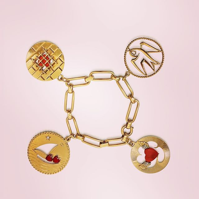 Retro Cartier Charm Bracelets, 14k and 18k, with coral and red enamel on the hearts on love boat charm. Bracelet 14k, signed Cartier #forsale #Cartier #retro #charmbracelet #fun #lovecharms #sailboatcharms #revivaljewels #cartiercharms #revivalvintagejewellry