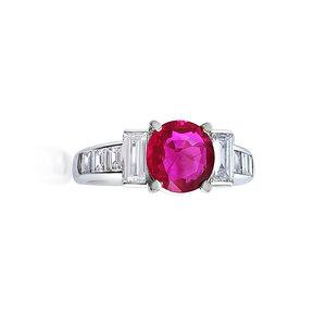 1e0d8ad28 An 18K Gold Ring by Tiffany & Co. A Ruby and Diamond Ring