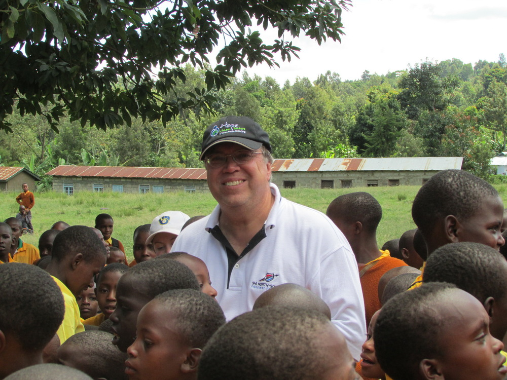 Executive Director Lance Parve with the school children in Tanzania-2013