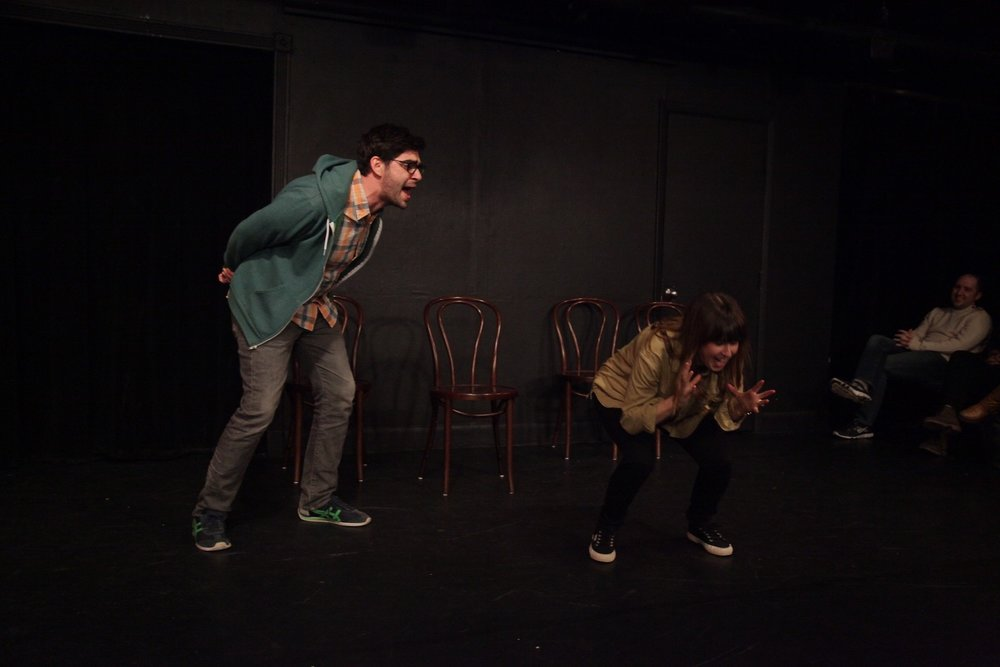 Performing improv (yelling) with (at) my wife at the UCB Theatre in NYC.