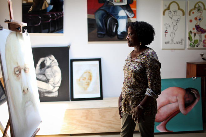 Painter Mercedes Nugent-Head stands in her studio, which she shares with painter Nikki Hotvedt. She said she paints with oil on mylar to give her work a light, translucent quality - DANIELLA ZALCMAN FOR THE WALL STREET JOURNAL