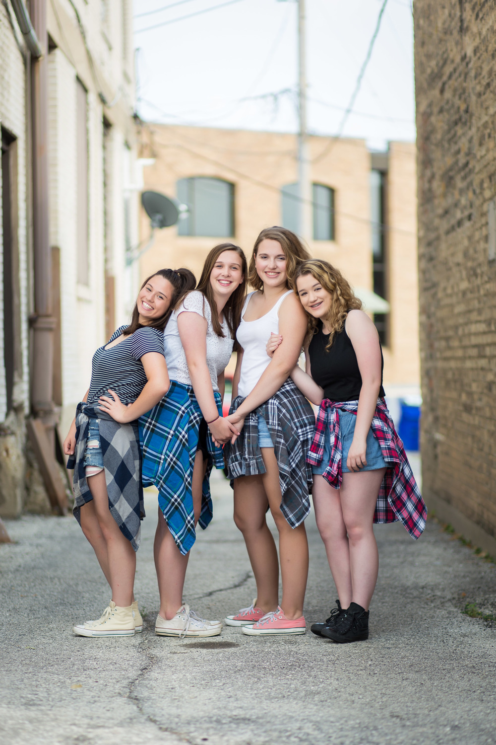group tween portrait of four girls in alley