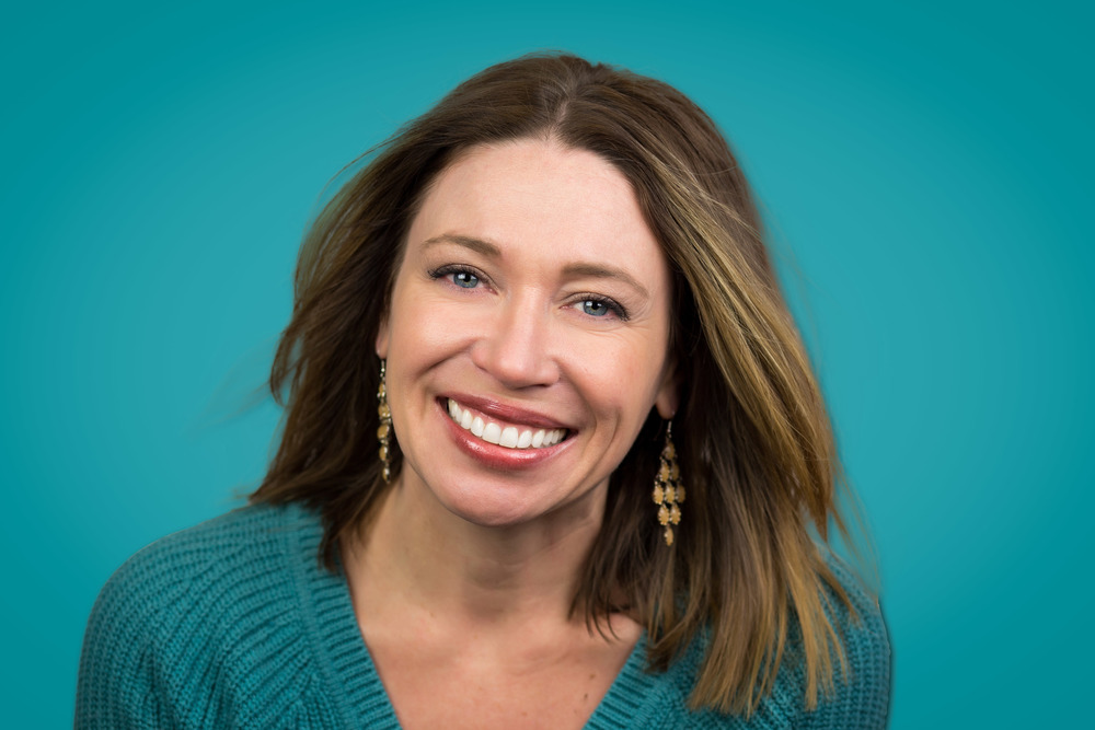professional headshot on teal background