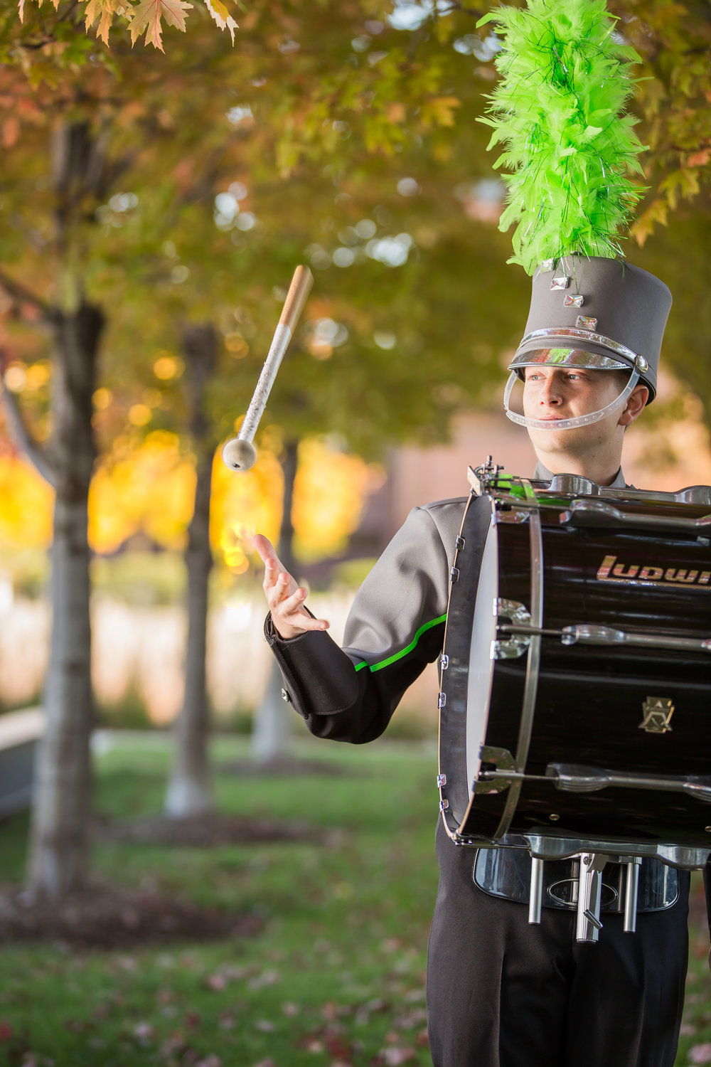 senior portrait of a marching band drummer