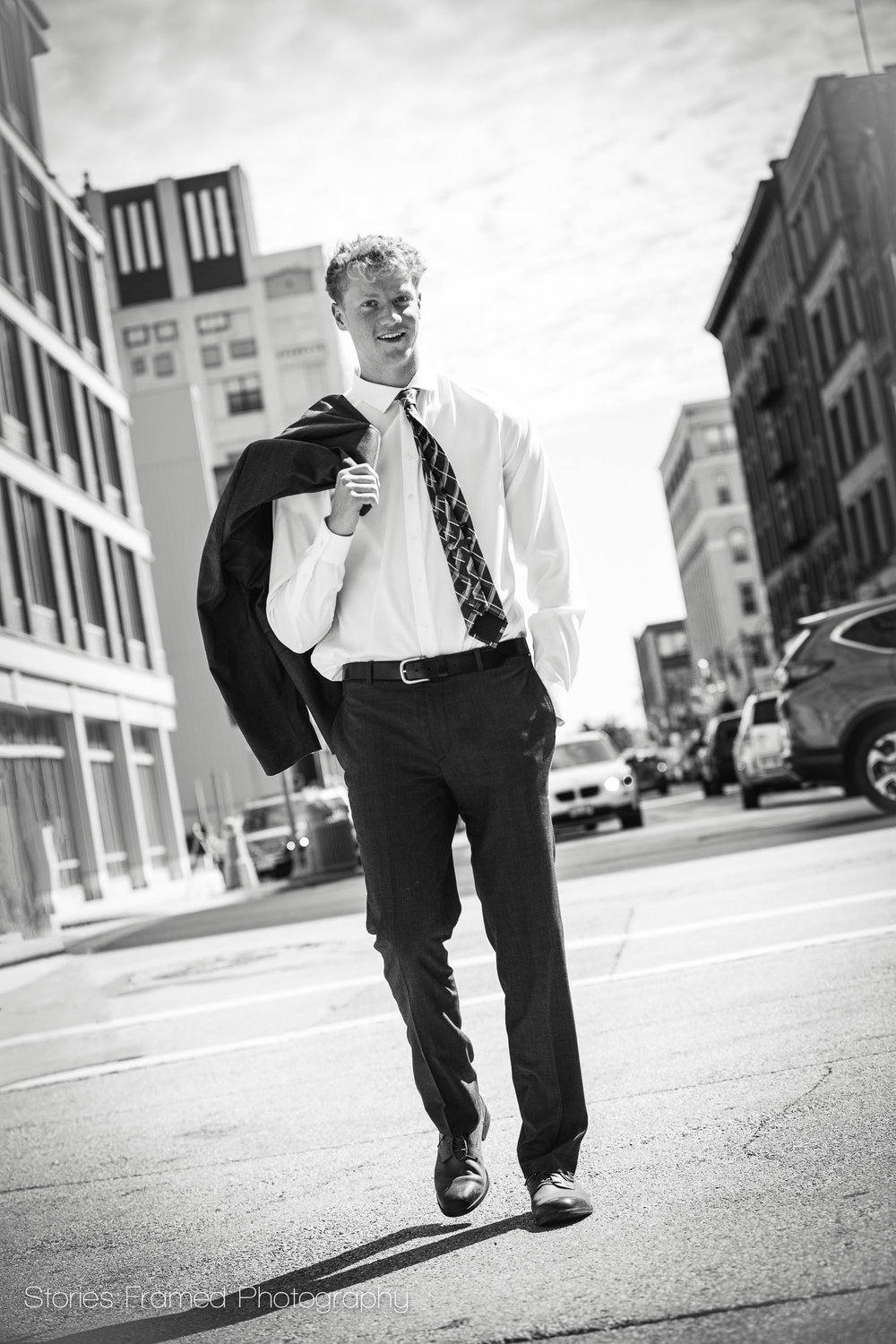 Joe-classof2018-walking-down-city-street-in-MKE