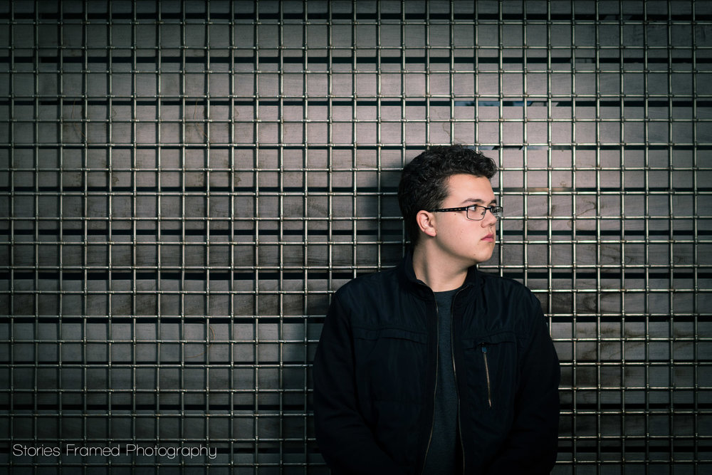 senior portrait in front of metal grid