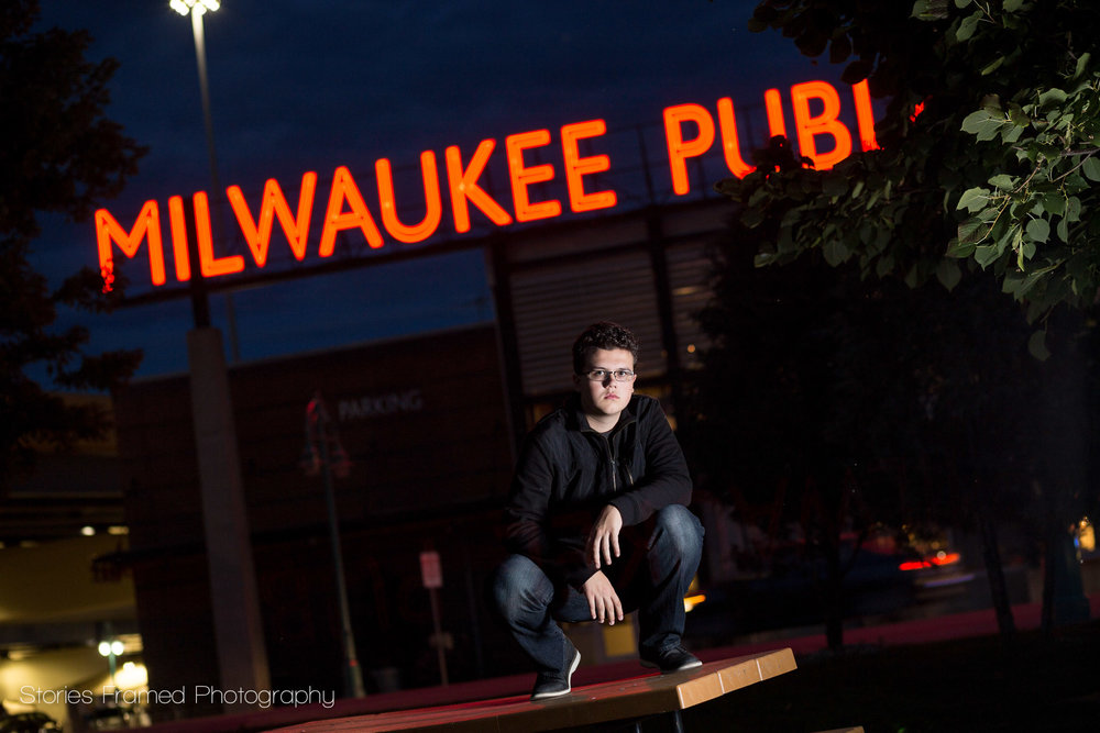 Milwaukee Public Market in senior portrait at night