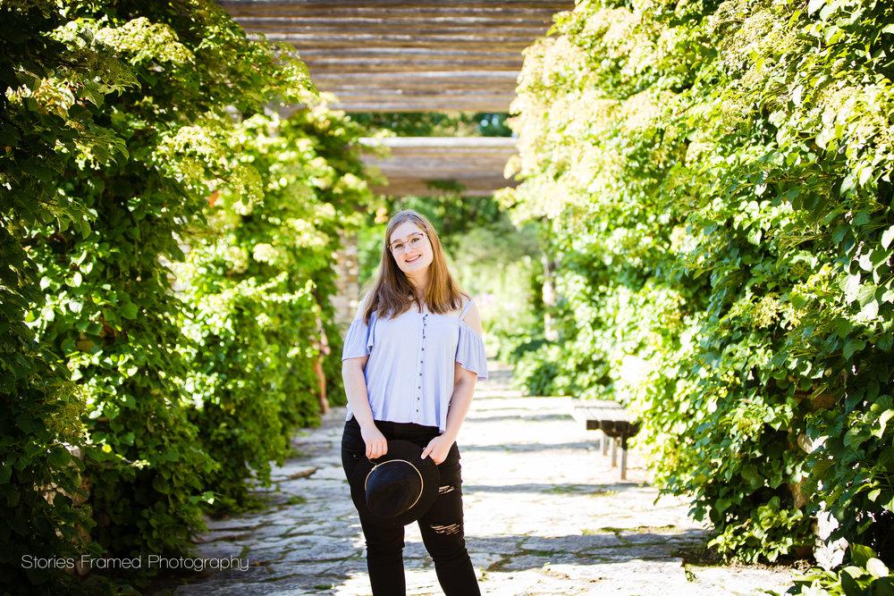 senior-girl-with-hat-Frame-Park.jpg