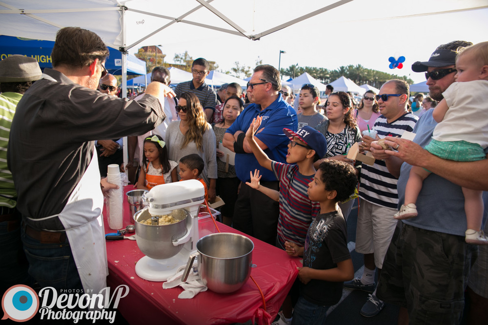 CEO Brett Bingaman making ice cream for a crowd at a local farmer's market!