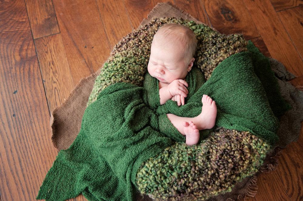 newborn baby boy in home