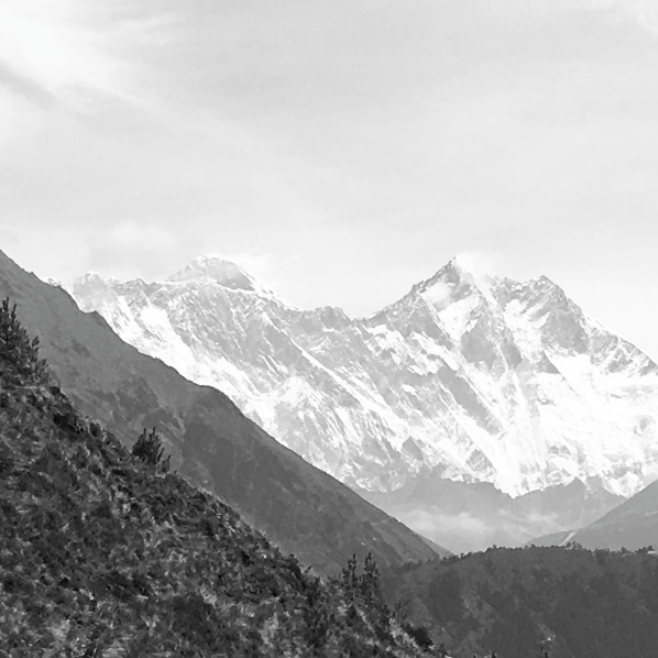 Everest is the one poking through on the left, Lhotse is the tall one on the right (4th highest peak in the world).