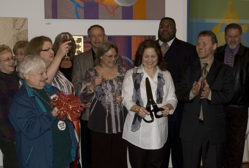 Above: The ribbon cutting at our grand opening in February 2010.  Below: Guests enjoy the celebration.