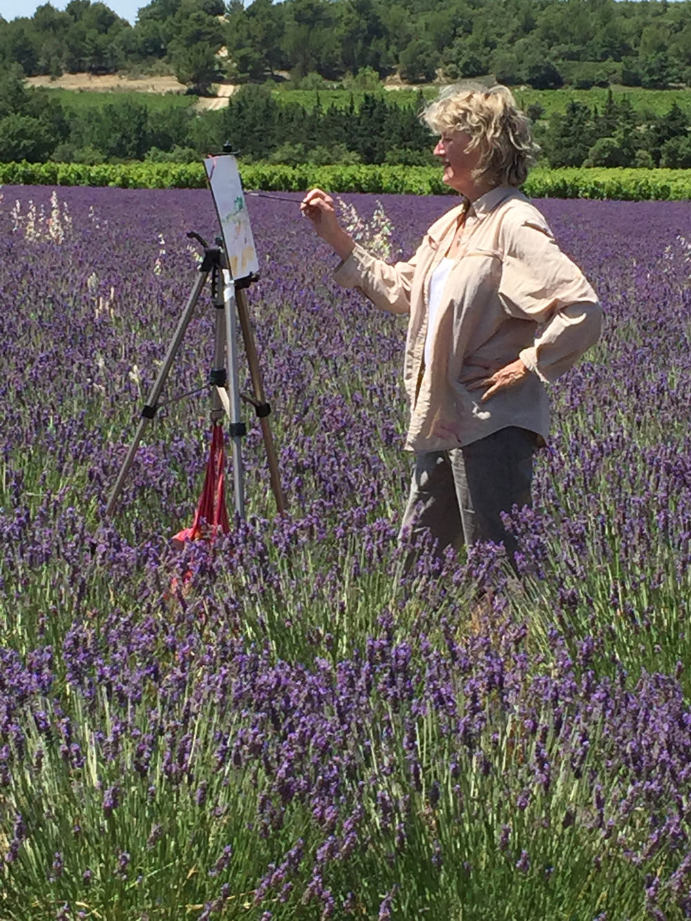 Mary Louise Porter painting in a French lavender field.