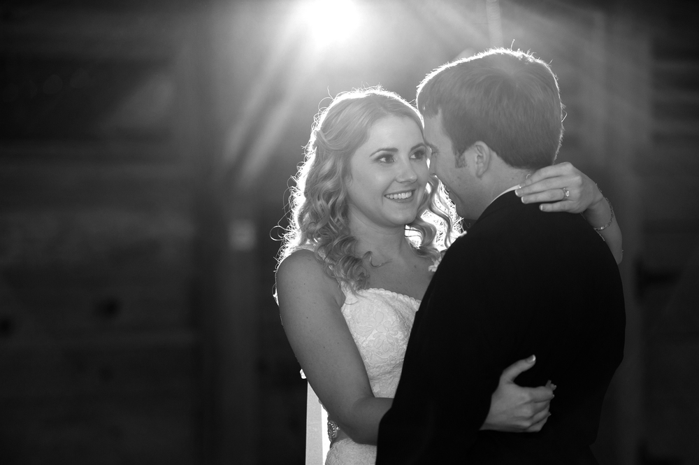 Bride looks at groom during first dance