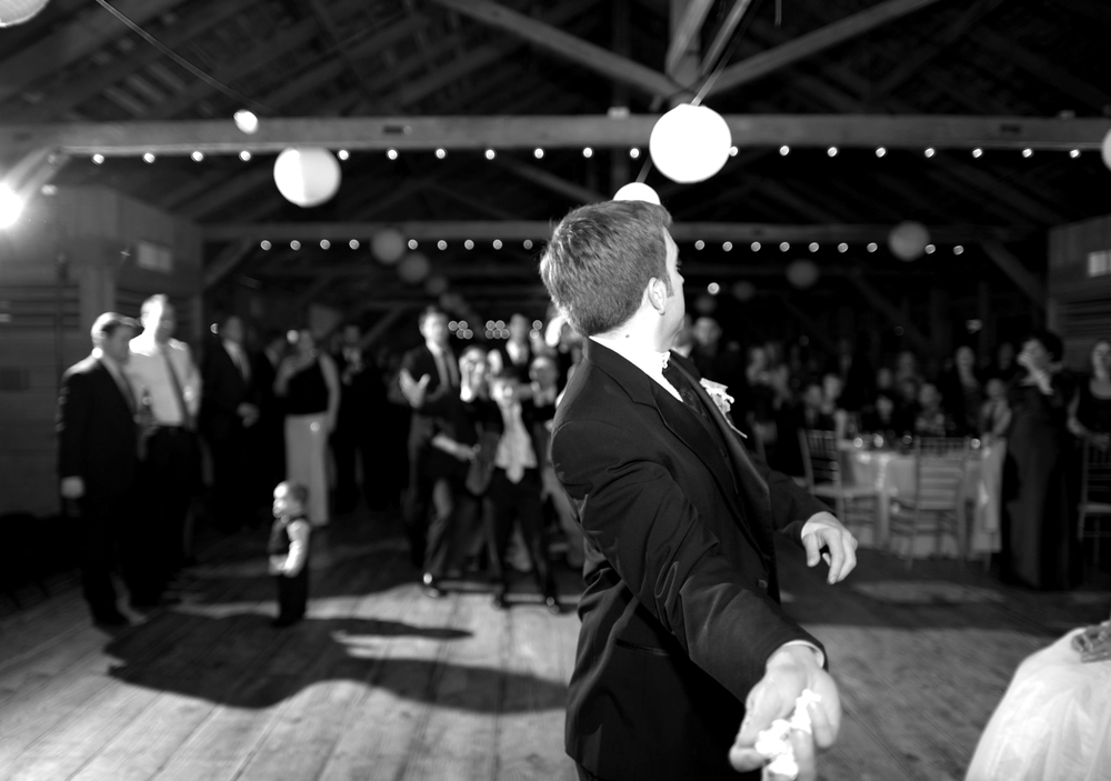 Groom throws Garter During Garter Toss