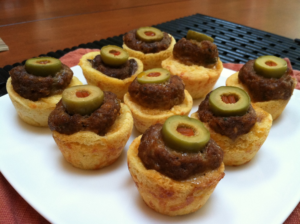 Scrumptious Eyeball Poppers - Taco Seasoned Meatballs baked in a Mini-Cheesy Corn Muffin