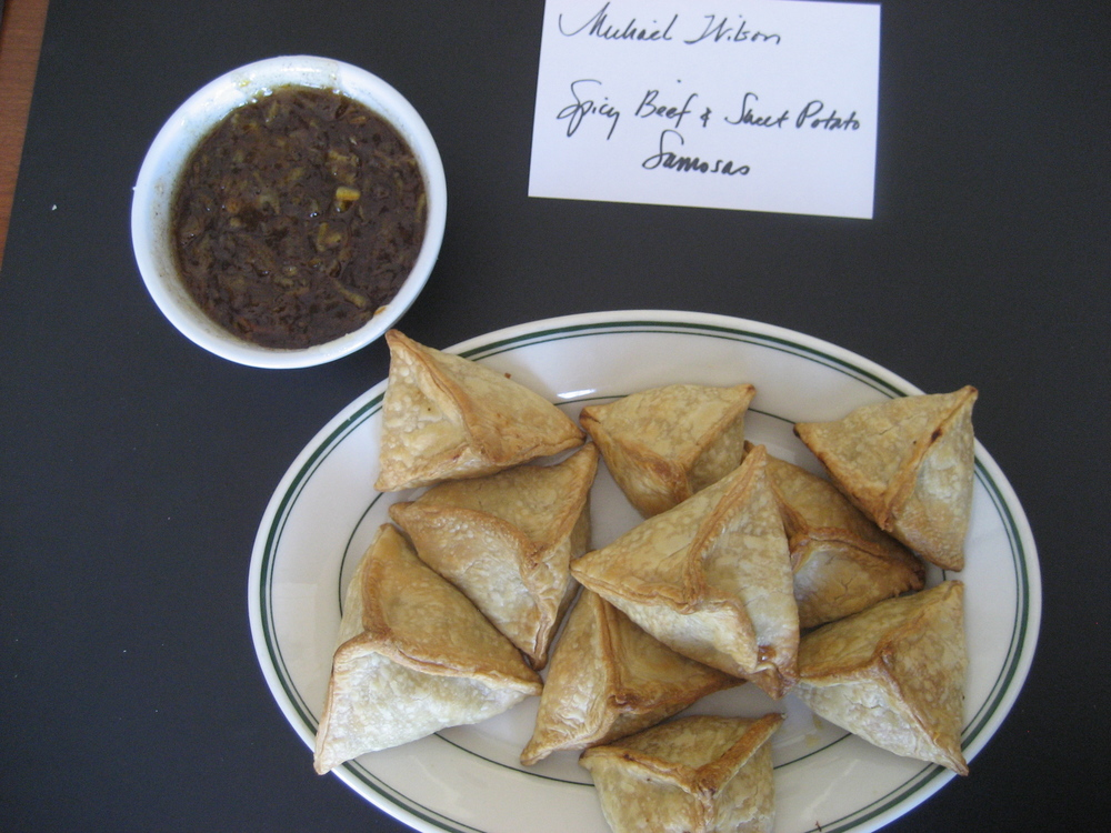 Michael Wilson, Design Director, used his eye for detail to craft Jennifer Fisher's   Spicy Beef & Sweet Potato Samosas  .  They were cooked to golden brown perfection and had a balanced savory/sweet flavor with just a touch of spice.