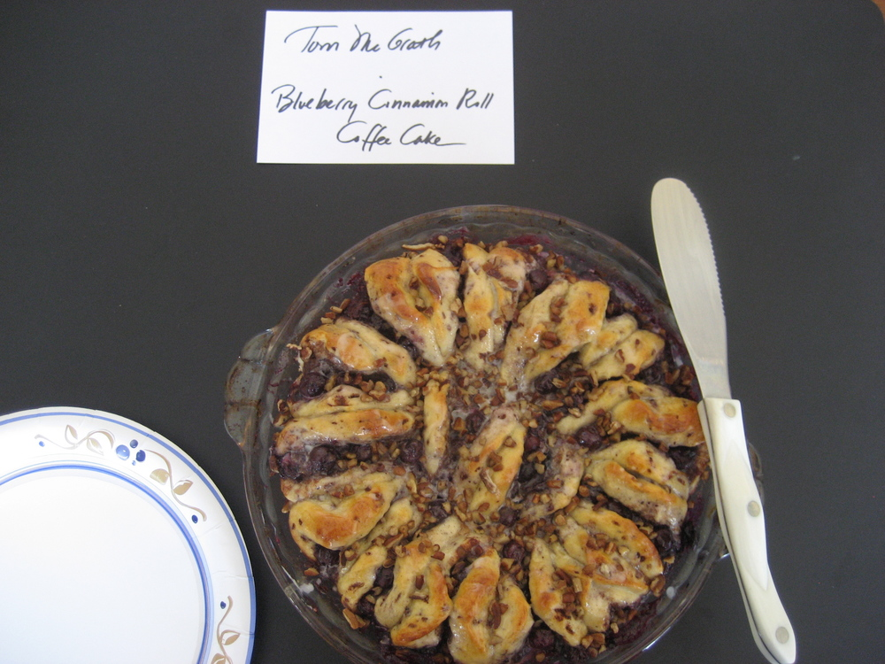 Tom McGrath, Editor, baked Marie Sheppard's   Blueberry Cinnamon Roll Coffee Cake  .  Mmm... this would be perfect for a relaxing weekend morning with a steaming cup of joe!  The cake was loaded with fresh blueberries which melded beautifully with the cinnamon and citrus flavors.  Toasty pecans topped off the dish and added a wonderful crunchy texture.