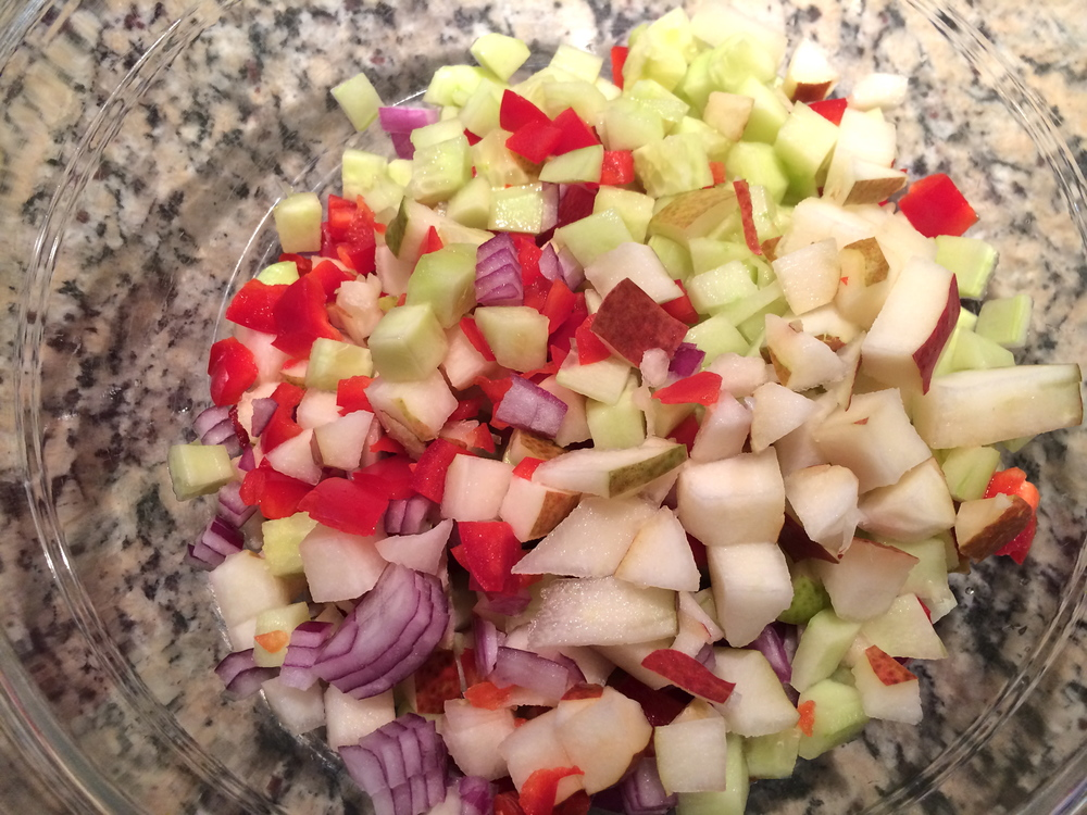 Chopped pear, pepper, cucumber and red onion.