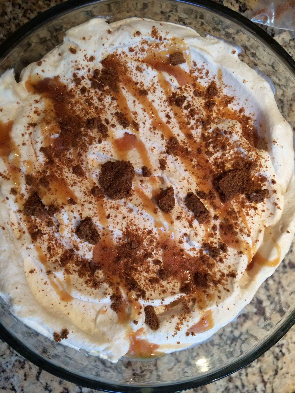 top with whipped cream, a drizzle of caramel and some cookie crumbs