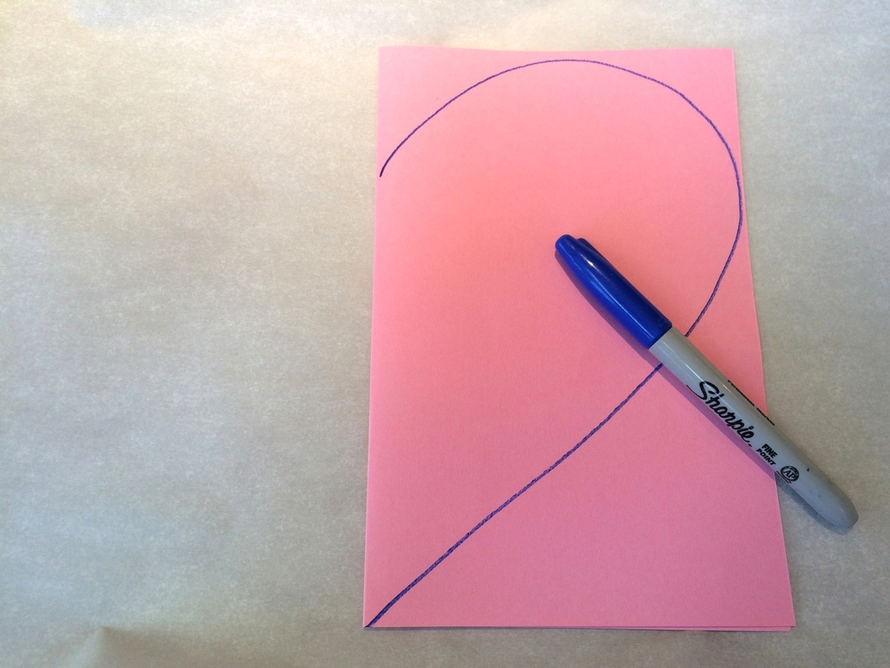Draw a 1/2 heart along the fold
