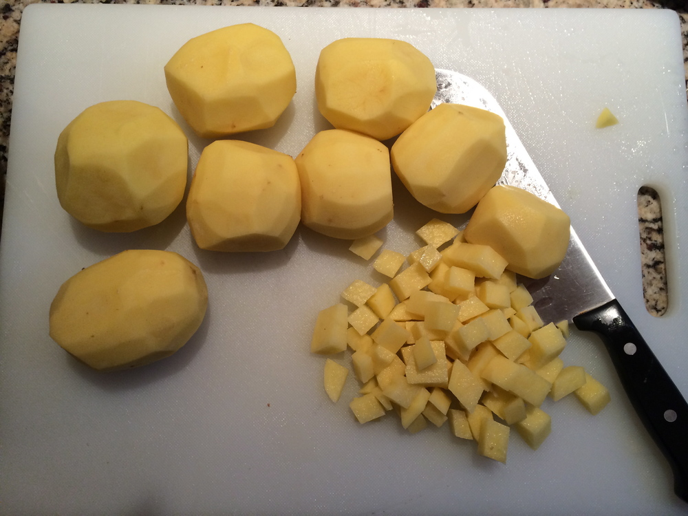 Peel and dice gold potatoes