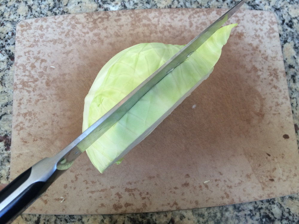 "Slice cabbage from top to stem in 3/4"" slices"
