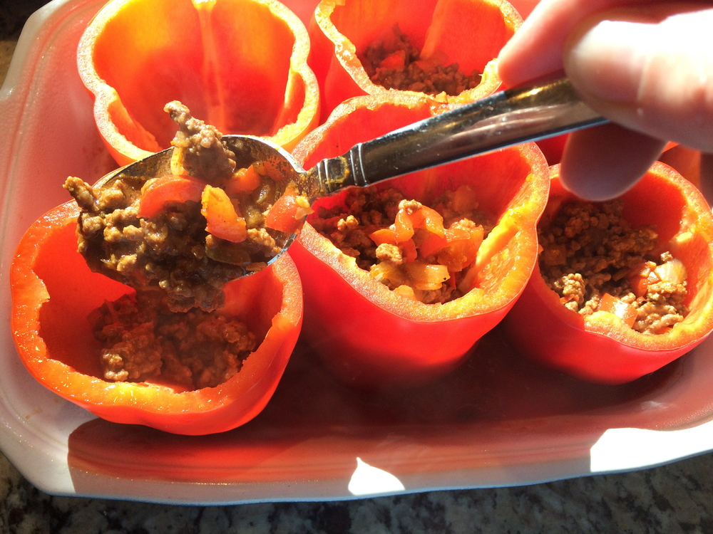 Fill peppers about 2/3 full with taco beef mixture.  Spoon any remaining mixture around the peppers.