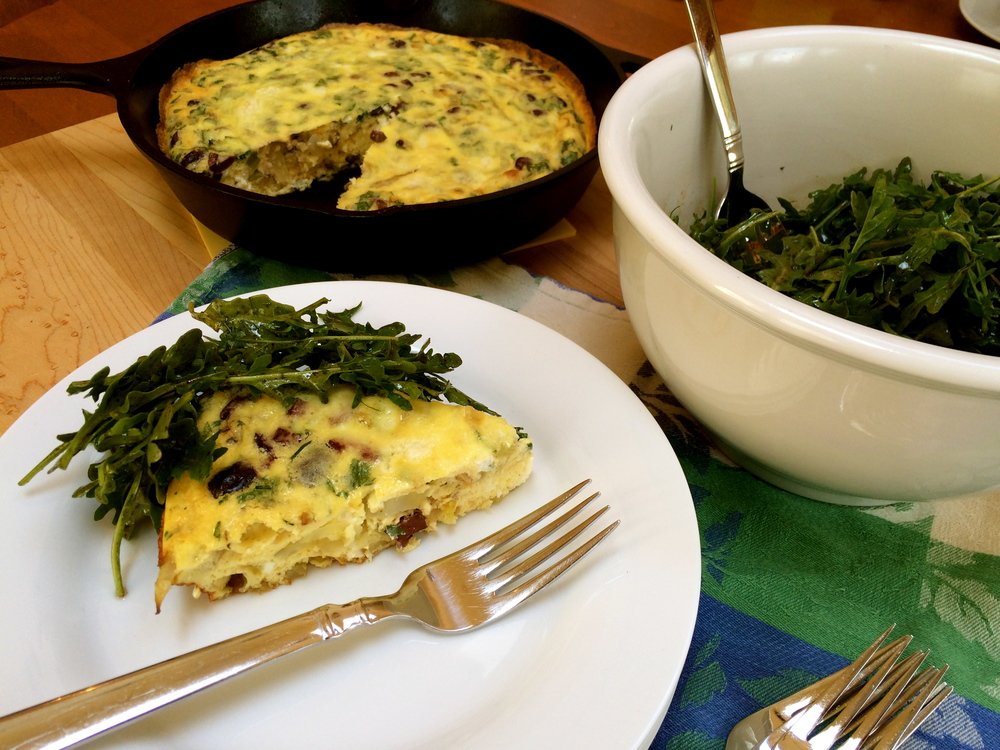 Toss the dressing with the arugula and serve with frittata - YUM!