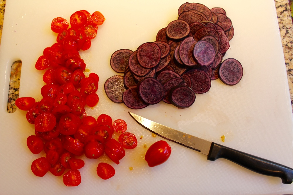 Slice the grape tomatoes
