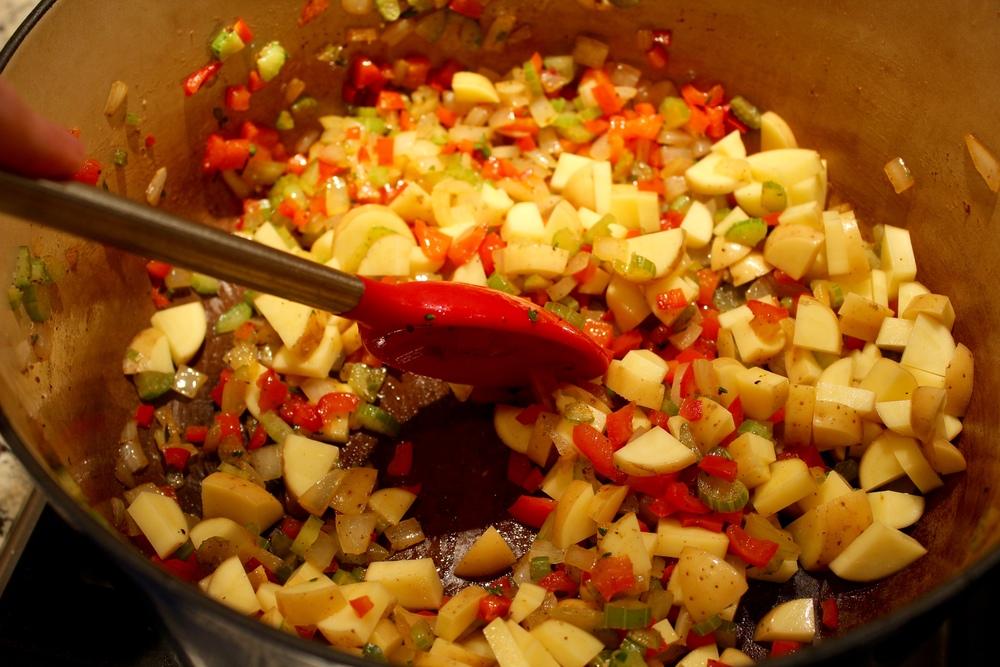 Stir in potatoes, seasonings and herbs.