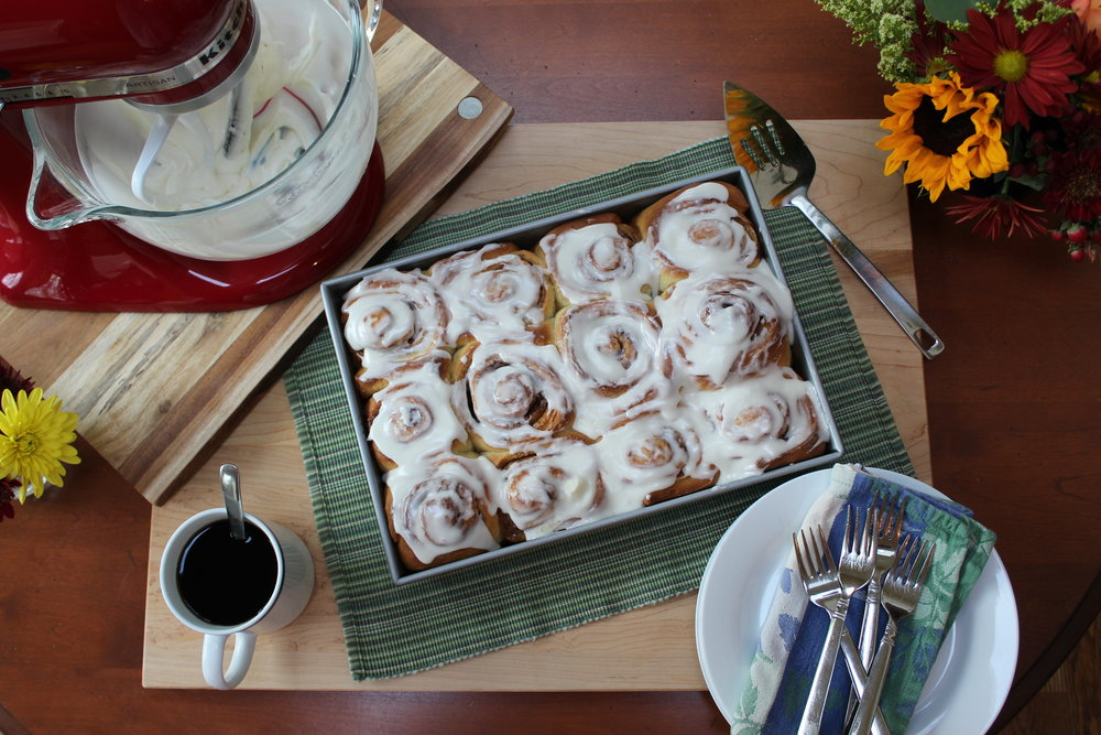 Slather on the icing when they're warm - then grab your coffee and dig in!