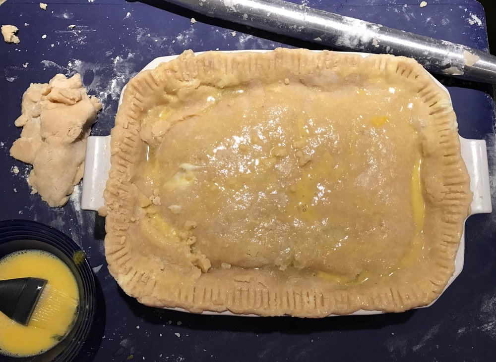 Cover with pie crust and brush with an egg wash.