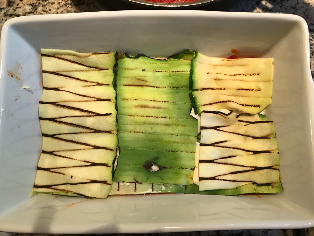 Add another layer of grilled zucchini sheets in other directions (perpendicular to previous layer).