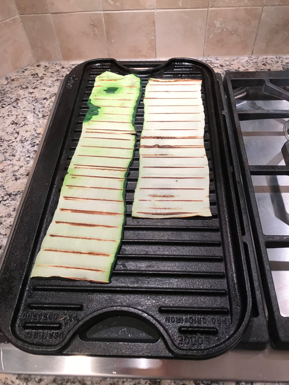 Grill the zucchini sheets for about 30 seconds on each side or until they are marked from grill and seem dry.