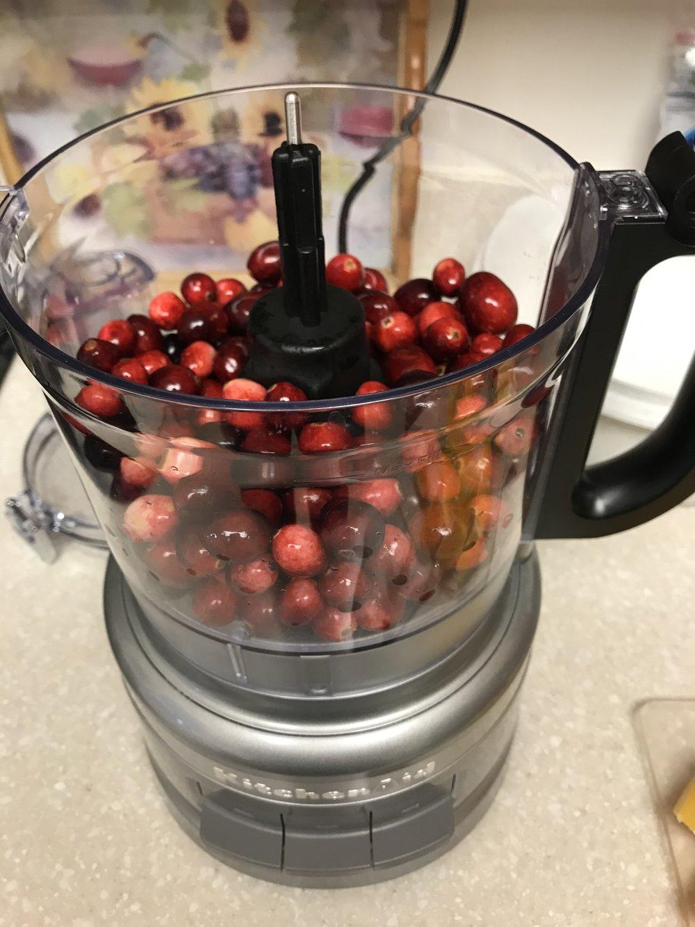 Chop half the cranberries...