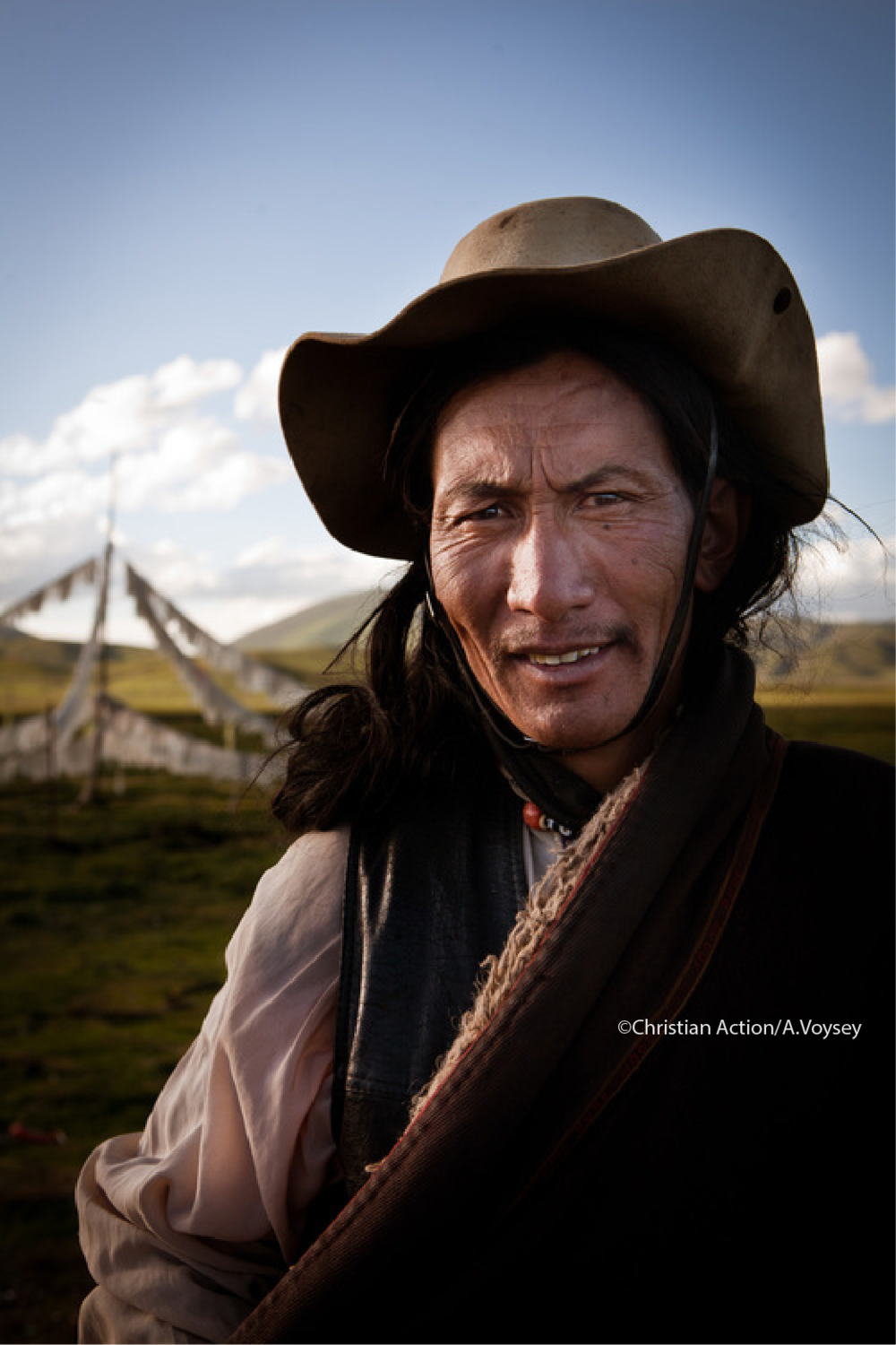 Christian Action Asia Copyright Images_Man in Hat.png