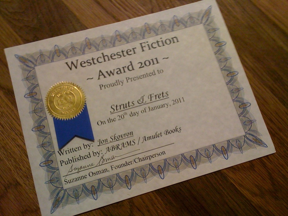 Struts & Frets has won the Westchester Fiction Award! I got a certificate and everything, see?!