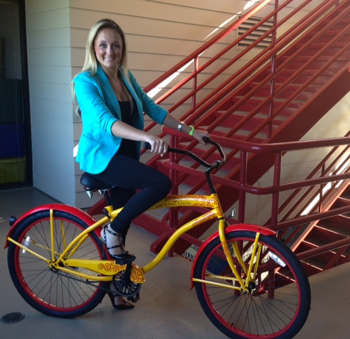 Just one of many great Silent Auction items to bid on at the art festival next weekend.  NOT Lexi Matthews (our volunteer coordinator!) who is aboard the bike, but the classic cruiser donated by Smoking Loon Winery!