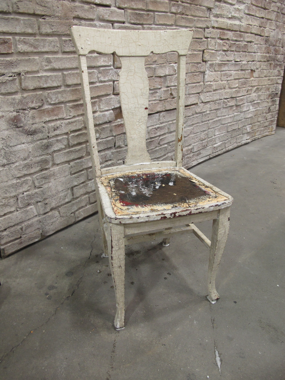 Off-white vinyl seated wood dining chair (distressed) $25