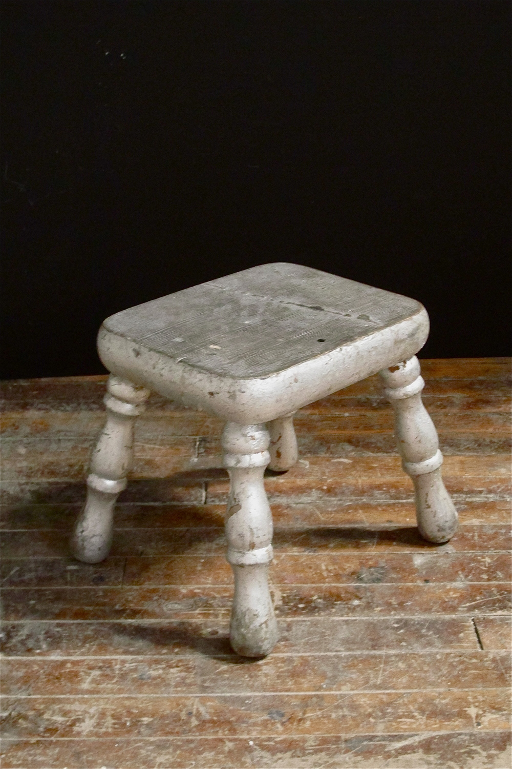 Small silver-leaf footstool $20