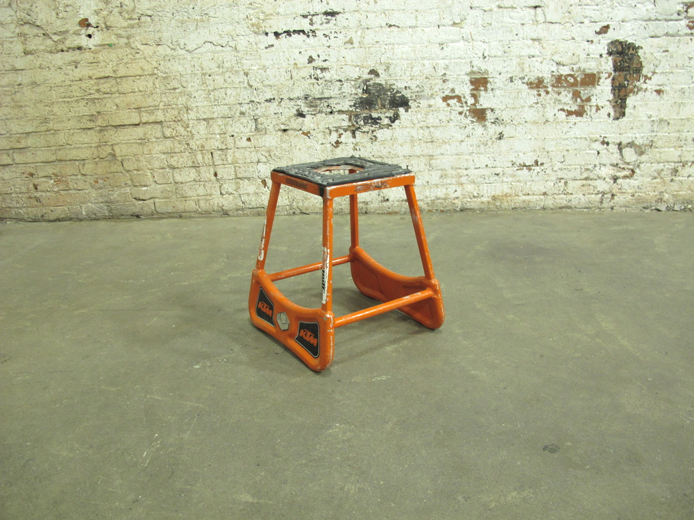 Short Orange Metal Mechanic's Stool $25