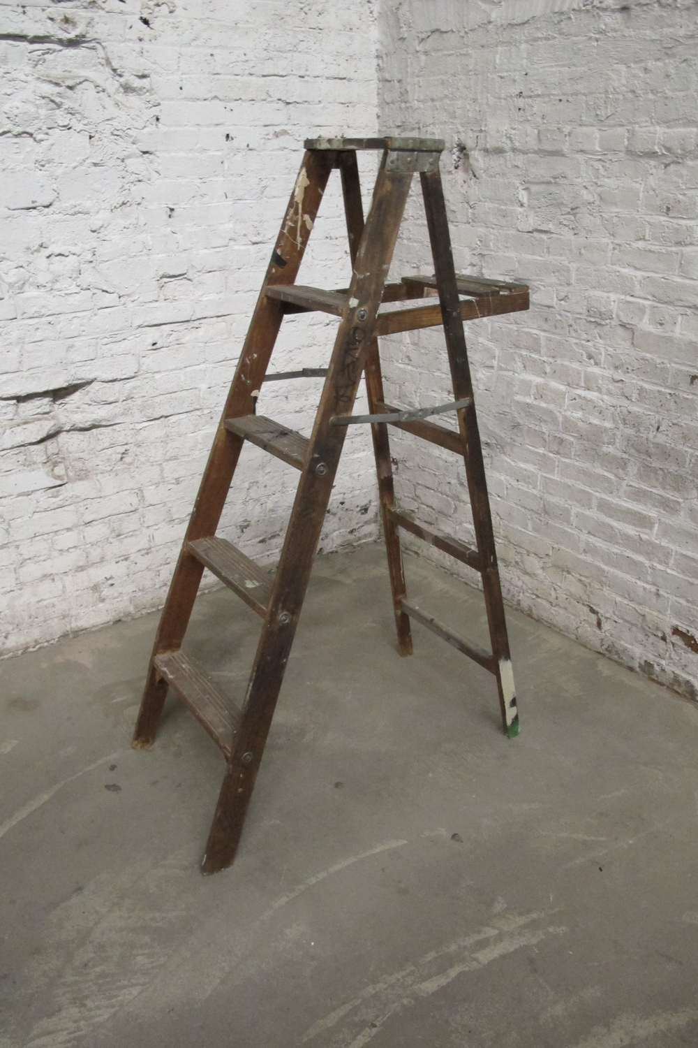 Dark Brown 4-step wood ladder (paint-splattered)