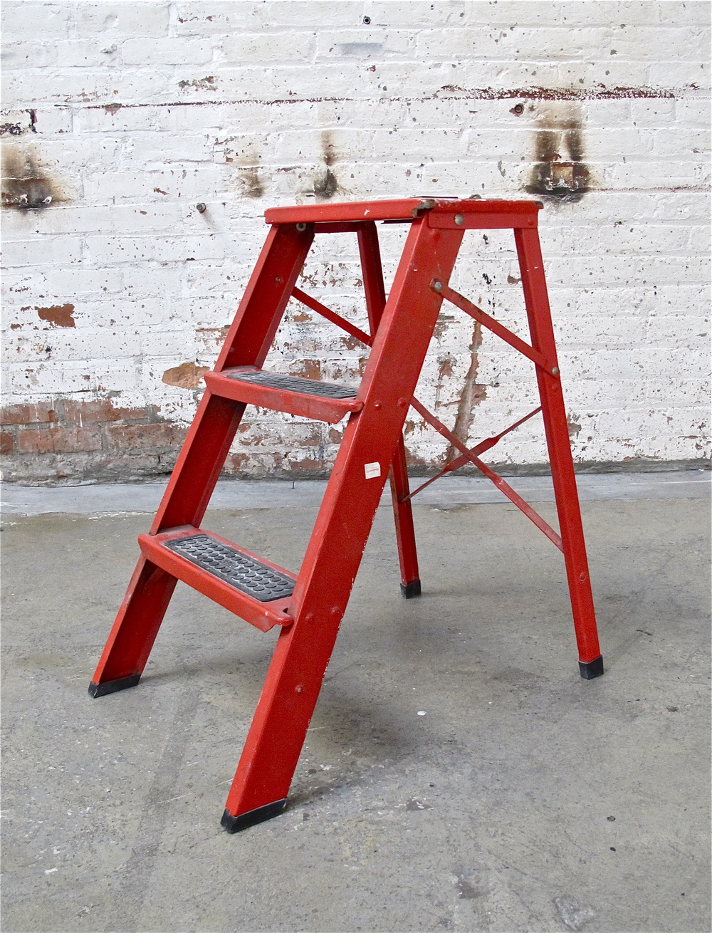 Red Metal two-step ladder