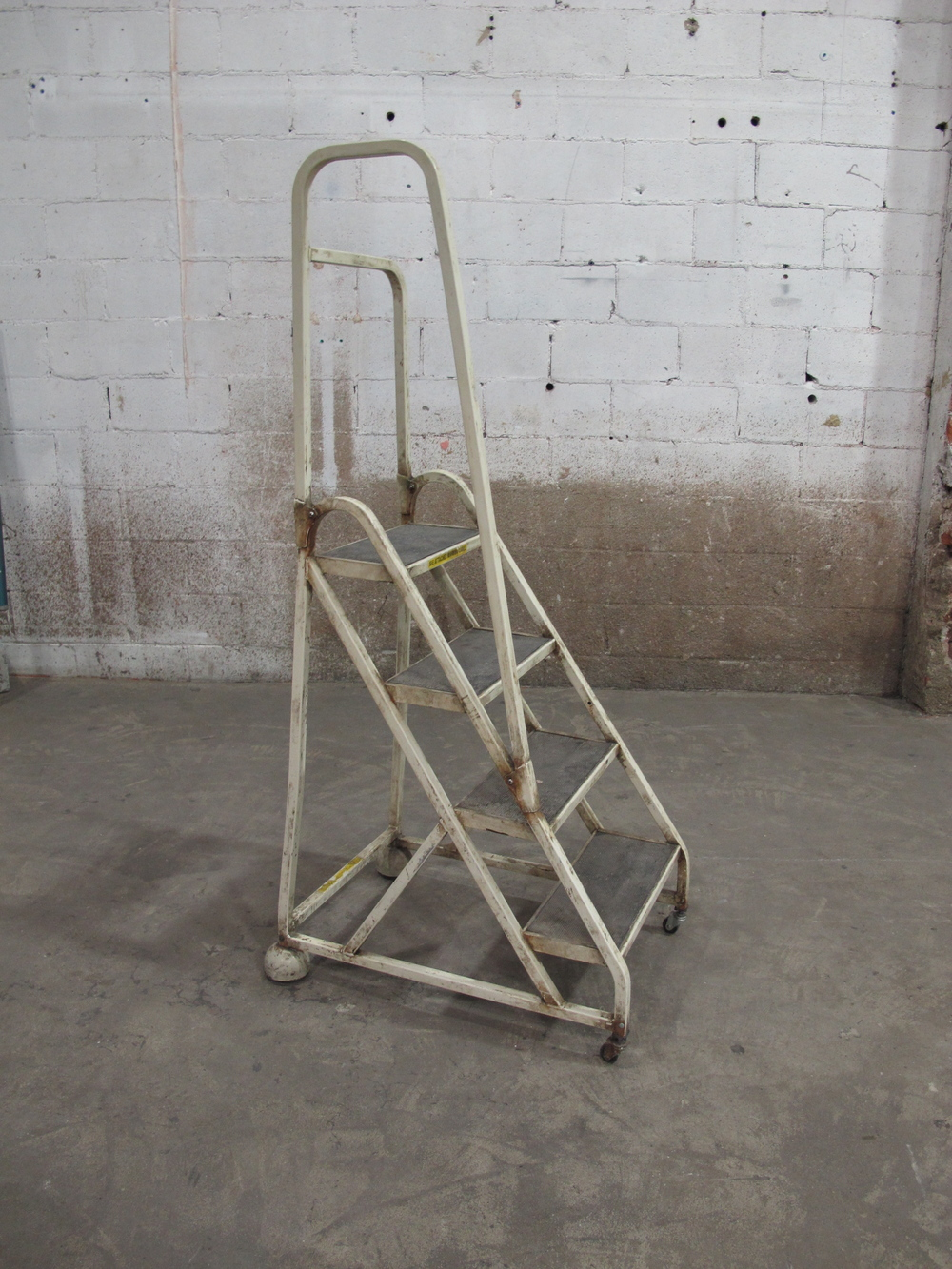 Off-white Metal Rolling Stairs $65