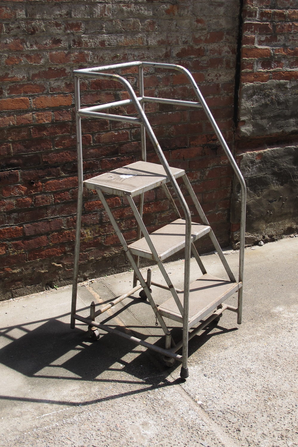 Silver and Black 3-step rolling ladder $40