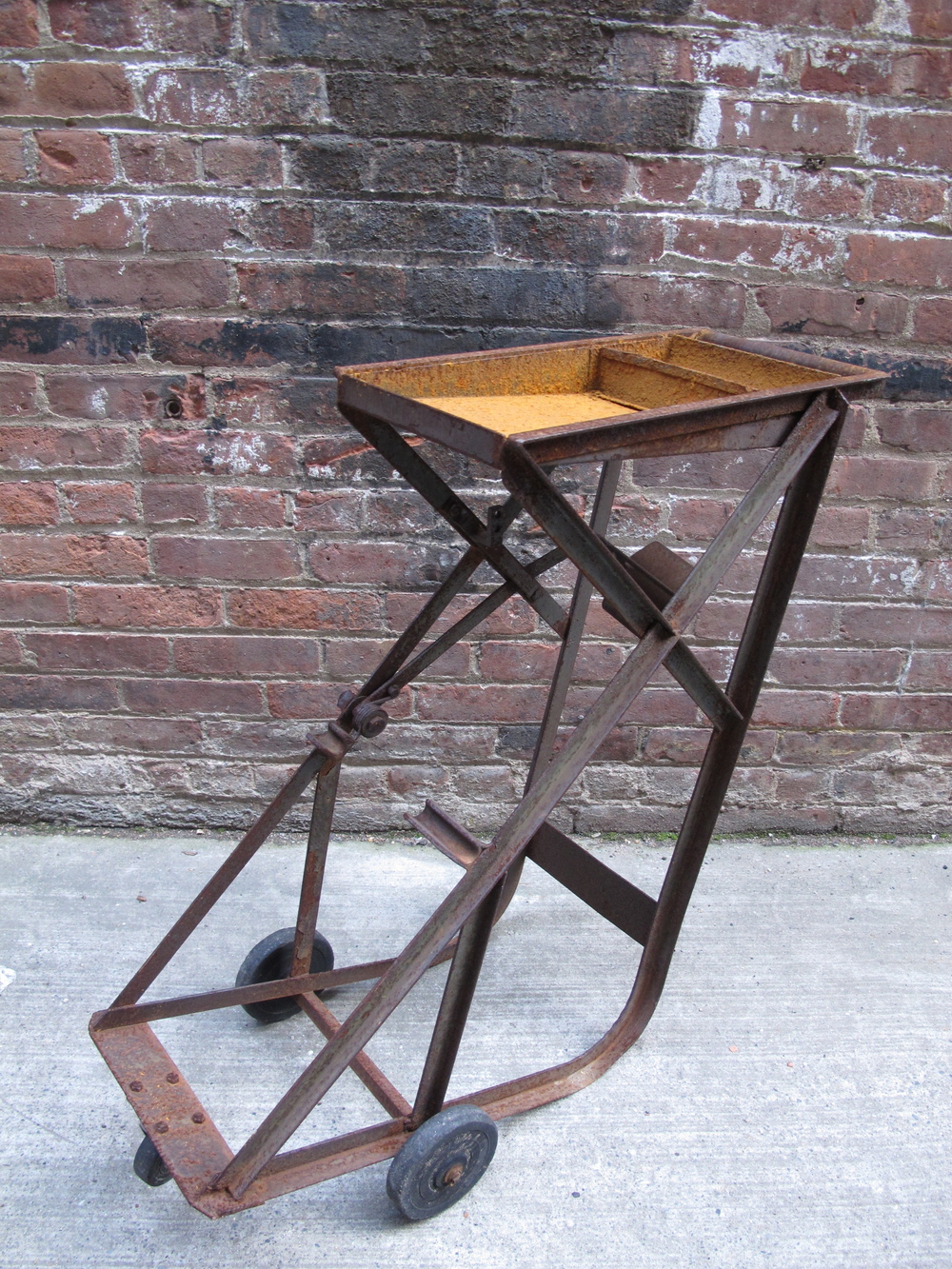 Rusted vintage metal rolling cart