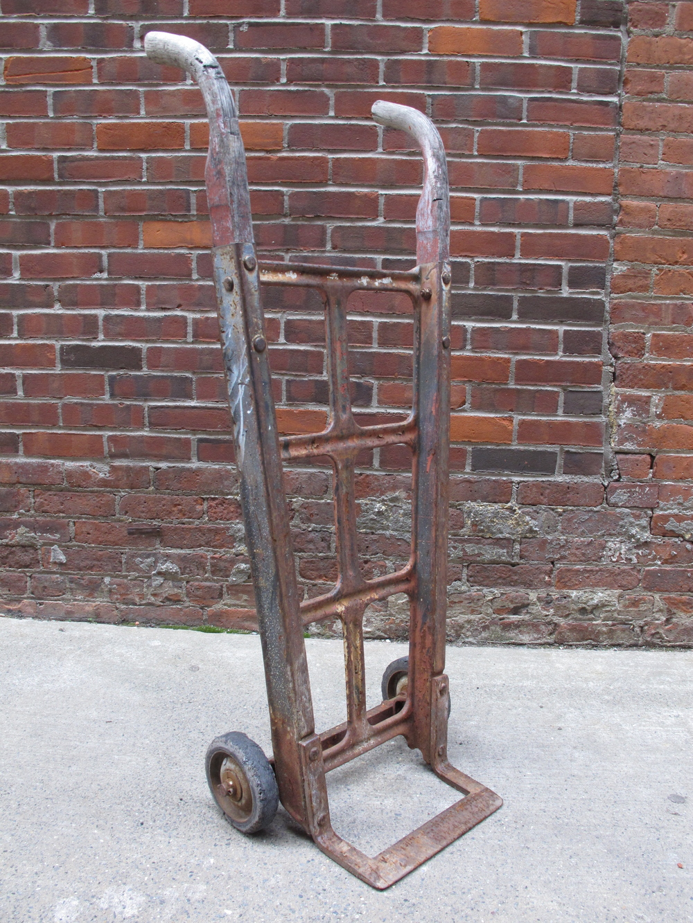 Wood and red rusted metal 2-wheeled dolly