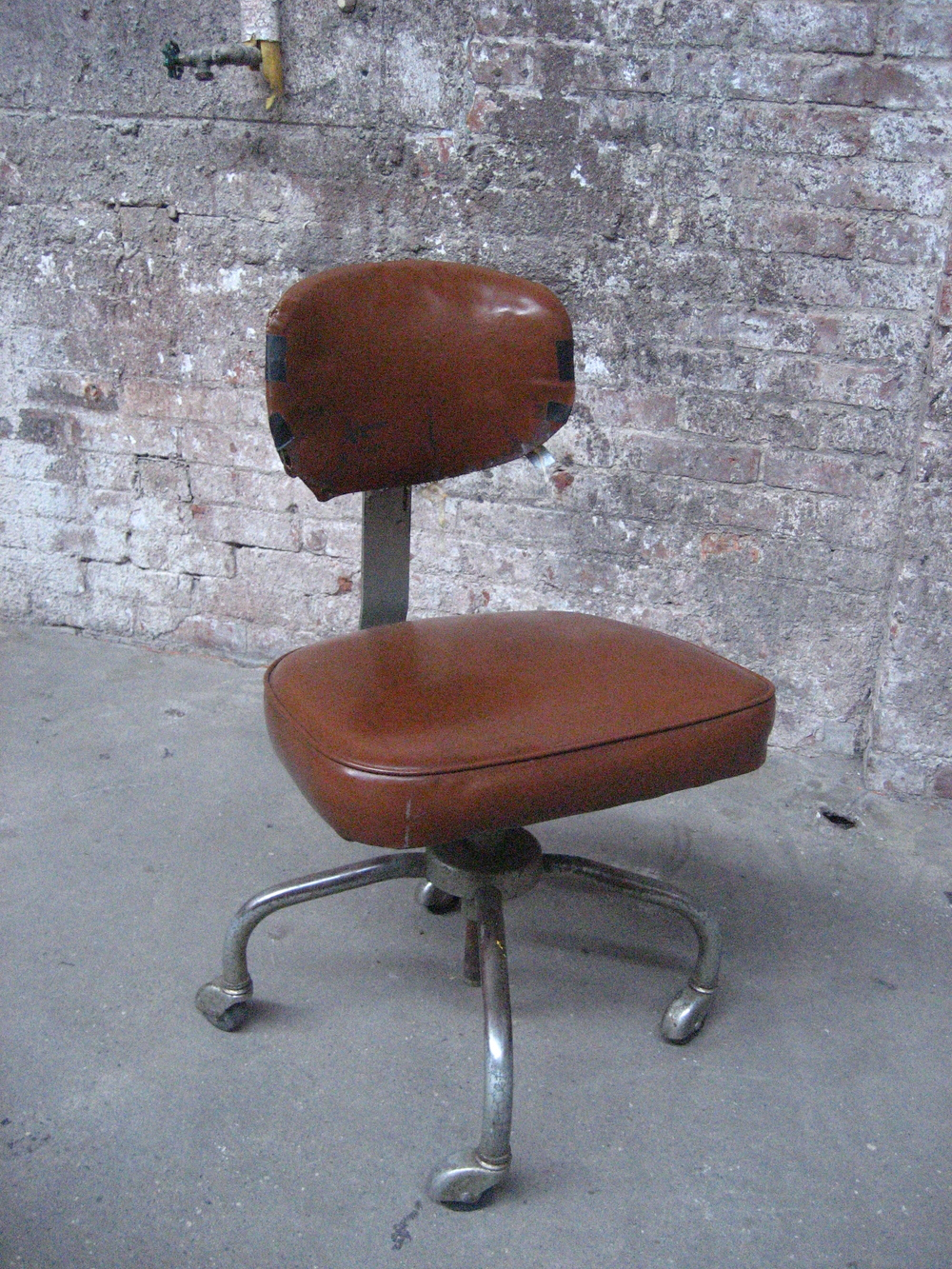 Rolling Brown Leather Accountant's Chair $45